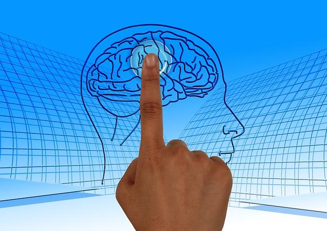Finger som peker på en hjerne